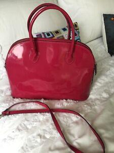 ladies pink patent leather bag.