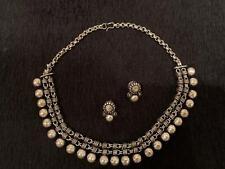 Silver choker and earrings