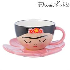 A wonderful cup and saucer set, featuring a charming face with fluttery lashes,