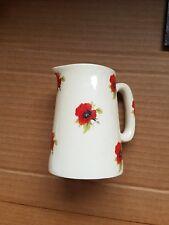 heron cross pottery poppy motif jug vintage