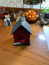 WOODEN BIRD HOUSE HAND PAINTED Barn Red with a black roof.