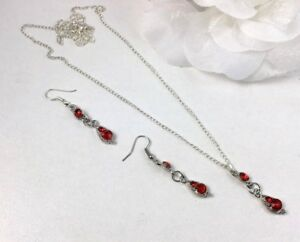 SILVER TONE TEAR DROP METAL & RED ACRYLIC CRYSTAL PENDANT NECKLACE EARRING SET