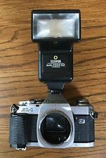 CANON AL-1   QF 35mm SLR Film Camera Silver Body With Flash.   Sold As Is