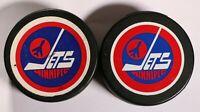 2 Vintage Winnipeg Jets Hockey Pucks NHL General Tire Viceroy