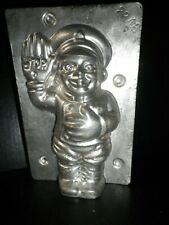 Vintage metal chocolate mold , cop with hand up to stop traffic, Walter, Berlin.