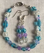 SP Earring & Bracelet Set Made With Various Blue, Purple & White Glass Beads.
