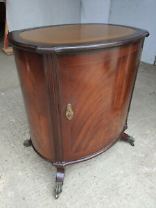 antique,repro,mahogany,oval,cabinet,cupboard,splayed legs,castors,drawer,leather