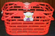 Orange Small Plastic Basket with Mini White Bear holding a Purple and Yellow Egg