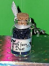 tooth fairy dust with a fairy charm and an organza bag