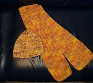 Ladies Orange mix hand knitted Beanie hat and Scarf.