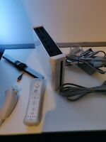 Nintendo Wii Console with controllers and all cables works great tested.