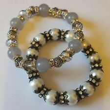 Two beautiful elasticated bracelets with beads and crystals