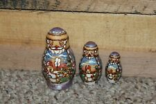 Three Christmas Santa Nesting Dolls Kodenera 3 In. To 1 3/4 Inches In Height