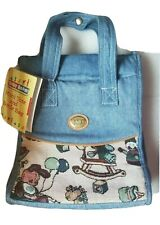New with Tag. Baby Boom Mini Tote, Bottle Bag Denim Material & Tapestry Detail