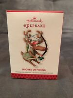 Hallmark Keepsake Christmas Ornament Hooked on Fishing Reindeer Angler 2013