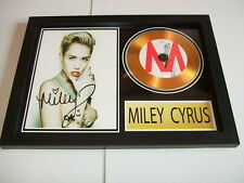MILEY CYRUS   SIGNED  GOLD CD  DISC 2