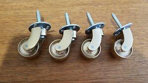 "4x Solid Polished Brass Castors 1"" (25mm) screw plate furniture castor - used"
