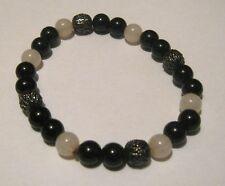Lovely elasticated beaded black milky white and pierced bronze beads