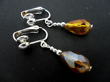 A PAIR OF SHORT AMBER GLASS   CRYSTAL TEARDROP CLIP ON EARRINGS. NEW.