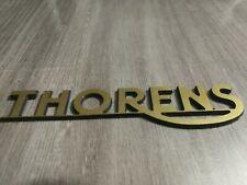 LOGO THORENS, PVC doré brossé,épaisseur 1.6 mm, dimension 107 x 25 mm