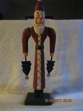 Midwest of Cannon Falls Carved Wood Santa holding tree in each hand