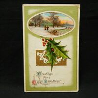 POSTCARD EMBOSSED GREETINGS FOR A HAPPY CHRISTMAS, HOLLY  POSTMARKED 1912