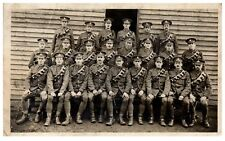 Postcard WW1 Royal Artillery Group at  Camp Outside Hut British Army RPPC 1a