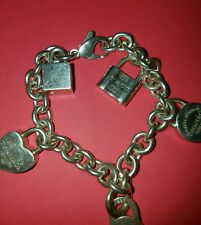 TIFFANY AND CO STERLING SILVER CHARMS BRACELET