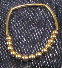 Lovely bracelet simple design elasticated with gold tone plastic beads & links