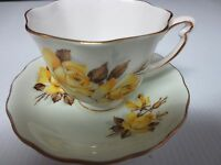 COLCLOUGH BONE CHINA YELLOW ROSES CUP AND SAUCER SET