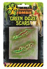 Skeletons zombies costume face paint and stage makeup - Zombie scars with glue ...
