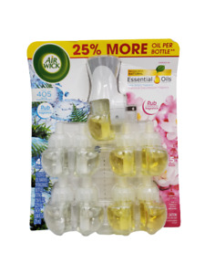 9 Air Wick Scented Oil Refills w/ Warmer Magnolia Cherry Blossom & Fresh Waters