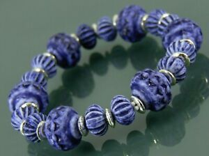 Statement bracelet with shabby chic antique style blue beads and silver spacers