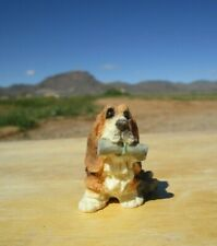 Adorable, Mini Basset Hound Dog Figurine, Sitting, Rolled Up Paper in Mouth