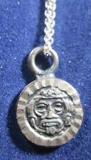 A 16 Inch Chain Sterling Silver Face Pendant With