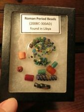 Ancient Roman Beads in small display box. Found in Libya