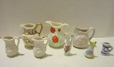 Vint lot of 8 small china & pottery pitchers- tulips, cherubs, flowers, face EC