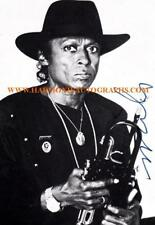 MILES DAVIS jazz legend signed photo with his trumpet.....Birth of Cool etc.