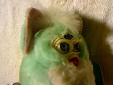 TIGER ELECTRONICS GREENISH BODY/WHITE BELLY/PINK EAR ELECTRONIC FURBY BABY TOY