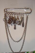 1 KILT PIN BROOCH ON A HAIRDRESSING THEME TIBETAN SILVER AND PLATED