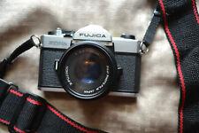 Fujica STX-1N Film camera with X-Fujinon 1:2.2 =55 mm lens, filter set,& manual