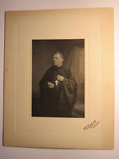 London England-Cleric with glasses in Cassock with Cross around the neck/Photo