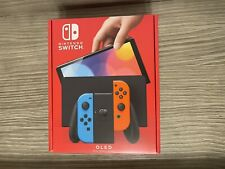 Nintendo Switch OLED model With Neon Red And Blue Joy Con New IN HAND