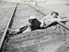 Vintage 1950 Snapshot Photo PRETTY WOMAN LAYING DOWN POSED ON RAILROAD TRACKS