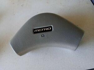 1989-1994 GEO METRO STEERING WHEEL HORN PAD     GRAY