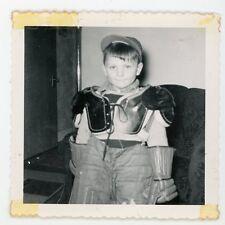 Little boy dressed in hockey gear. childhood memories -  Vintage snapshot photo