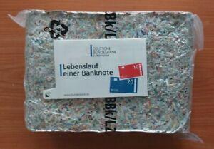 Geschredderte Euro Geldscheine/ Banknoten der Bundesbank als Brikett gepresst