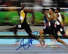 Fastest Man Alive Usain Bolt Signed Photo 8x10 COA 3