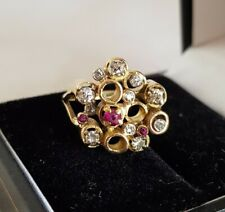18ct gold Dress ring.Set with a Rubies & Brilliant cut Diamonds .Sheffield 1976