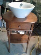 Duravit Unique Wood Vanity Cabinet with a Vessel Vase Sink.